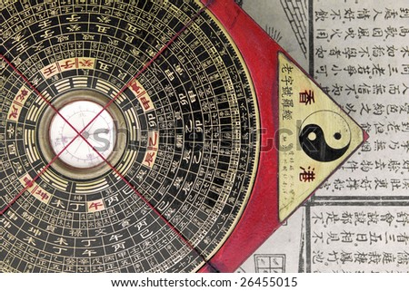 antique chinese compass for  feng shui - stock photo
