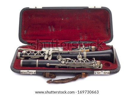 Antique Clarinet broken down in its travel case Isolated on white - stock photo