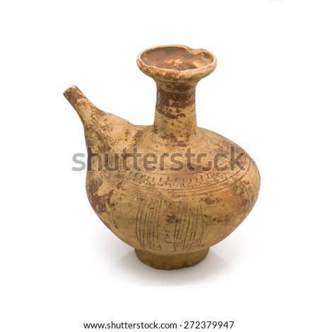 Antique clay ewer isolated on white background. - stock photo