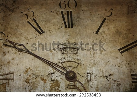 Antique clock face with hour and second hand. Engraved Roman numerals and decimal numbers. - stock photo