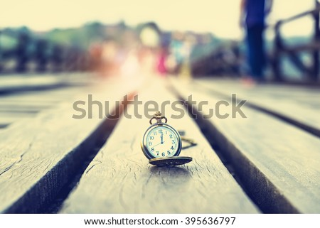 Antique clock on a wooden bridge - Time and Life Concept - stock photo