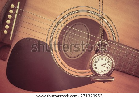 Antique clock vintage and guitar. vintage - stock photo