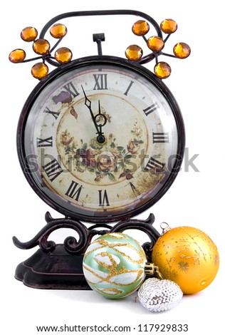 Antique clock with New Year's spheres - stock photo