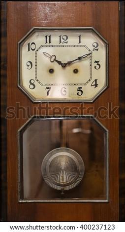 antique clock with pendulum - stock photo