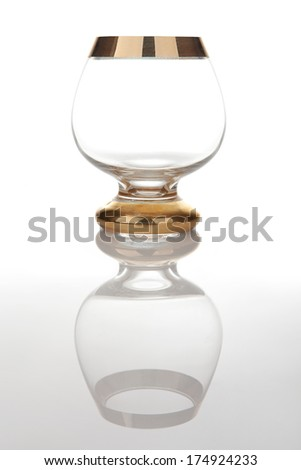 Antique cognac glass with reflection - stock photo