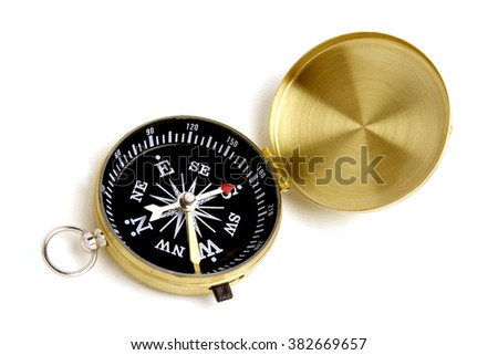 Antique compass on white background - stock photo