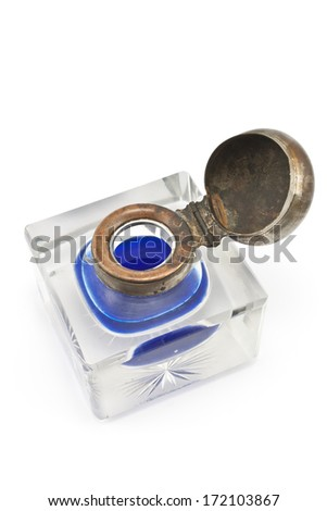 Antique crystal inkwell with blue ink isolated on white - stock photo