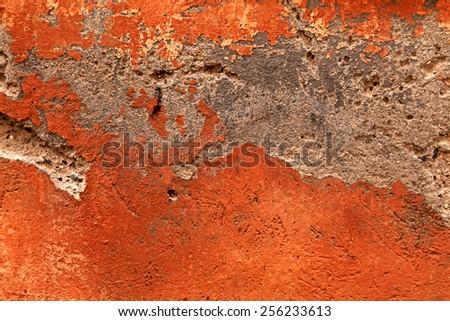 Antique damaged orange concrete plaster texture background - stock photo
