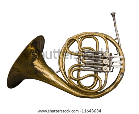Antique dented French Horn well loved and weathered by time. - stock photo