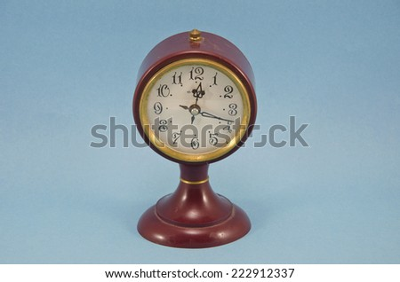 antique design vintage clock on blue background - stock photo