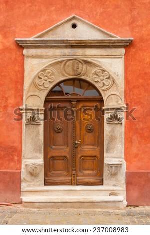Antique door in the medieval town of Cesky Krumlov, Czech Republic - stock photo