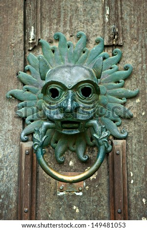 Antique door knocker at the front door of Durham Cathedral, England - stock photo