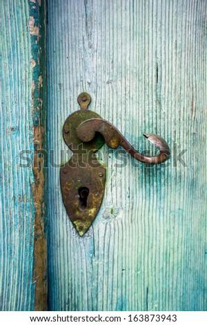 Antique Doorknob on a light blue wooden door - stock photo