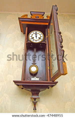 Antique drum head grandfather clock  on a wall - stock photo