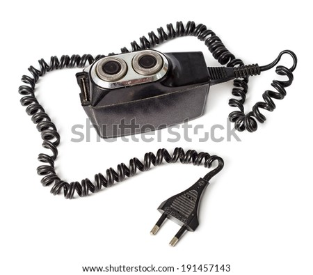 Antique electric razor. Old shaver isolated on white background - stock photo