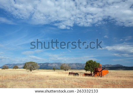 Antique farming equipment located at Smith Mesa, nearby Zion National Park, Utah. Pine Vally Mountain lies in the background. - stock photo