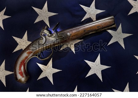 Antique flintlock pistol made in the late 1700's. - stock photo