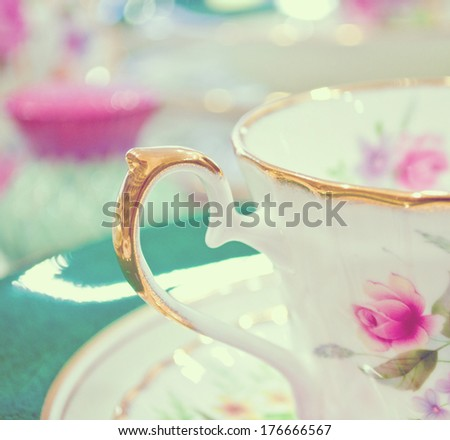 Antique floral tea set macro shot - stock photo