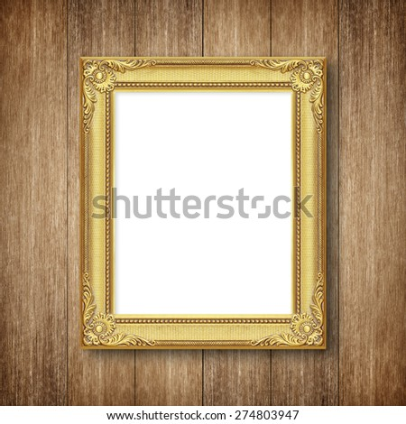 antique frame on wooden wall - stock photo