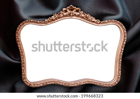 Antique frame with blank copy space, black fabric background - stock photo