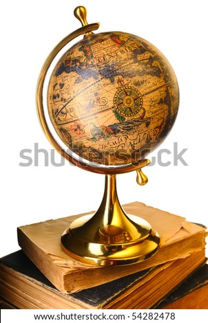 Antique globe on old books isolated over white - stock photo