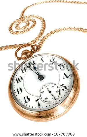 Antique golden pocket watch with chain, showing a few minutes to midnight isolated on white background. Concept of time,the past or deadline. - stock photo