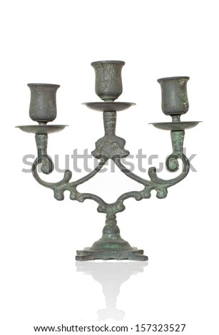antique green candlestick on white - stock photo