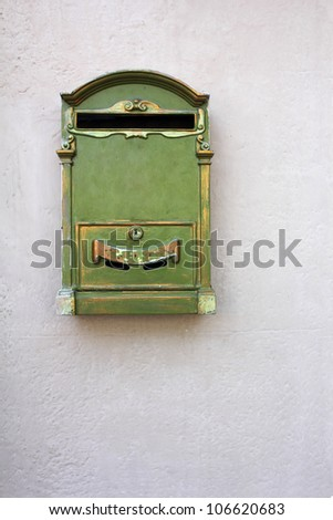 Antique Green Letter Box on the wall - stock photo