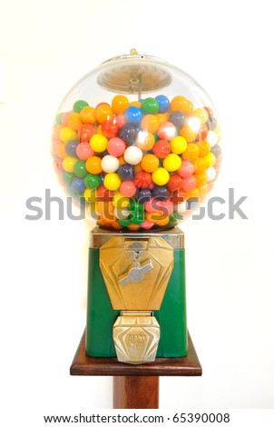 Antique gumball machine isolated on white. - stock photo