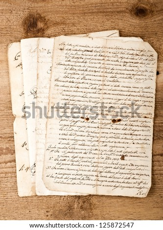 antique hand writings  on wood background - stock photo