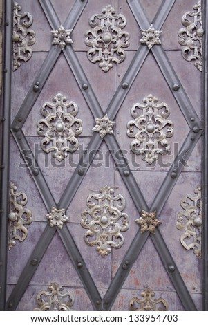 antique iron door with ornaments - stock photo