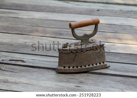 antique iron, Old iron, Old coal iron on the old wooden floor. - stock photo
