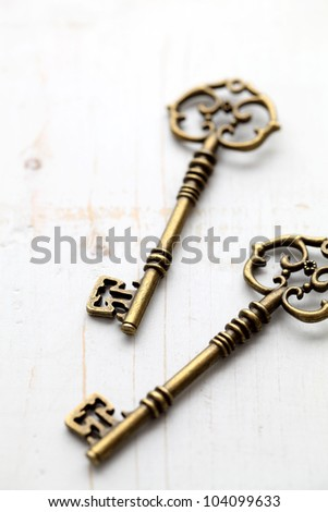 Antique keys on wooden table - stock photo