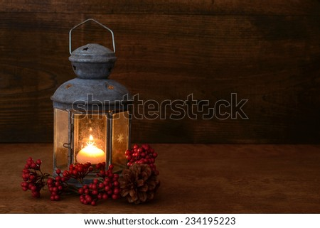 antique lantern with red berries - stock photo