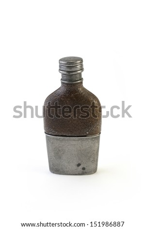 Antique leather covered hip flask. - stock photo