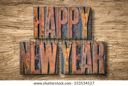 Antique letterpress wood type printing blocks - Happy New Year - stock photo