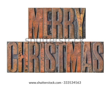 Antique letterpress wood type printing blocks on a white background - Merry Christmas - stock photo