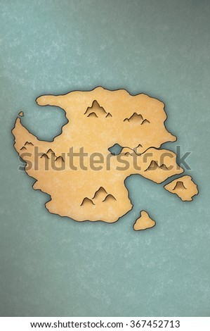 Antique-looking map of an island on papyrus-like paper - stock photo