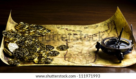 Antique map, coins, compass and other piratical stuff - stock photo