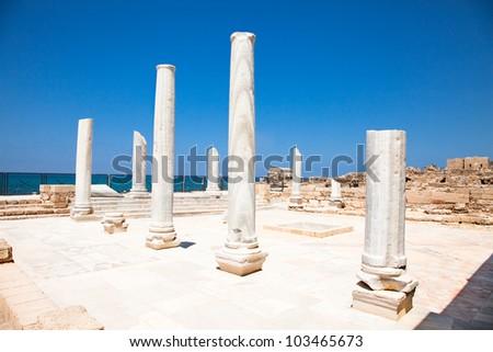 Antique marble pillars in Caesarea. Israel. - stock photo