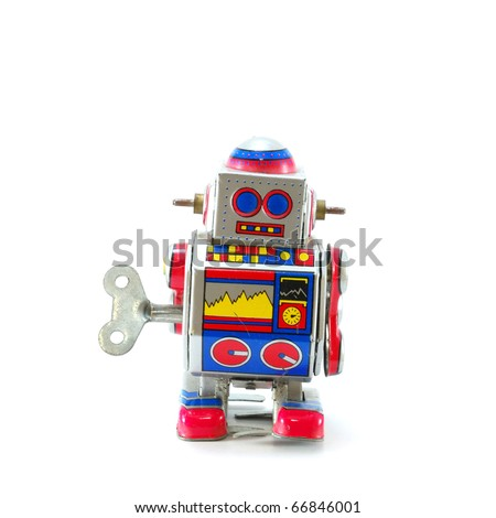 ANTIQUE MECHANICAL TOY ROBOT - stock photo
