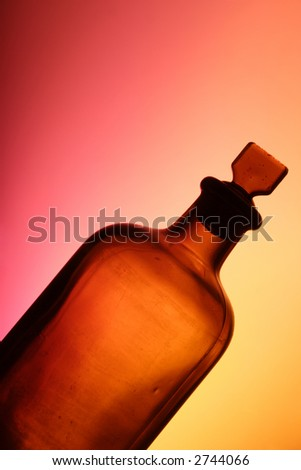 antique medicine glass bottle and stopper - stock photo