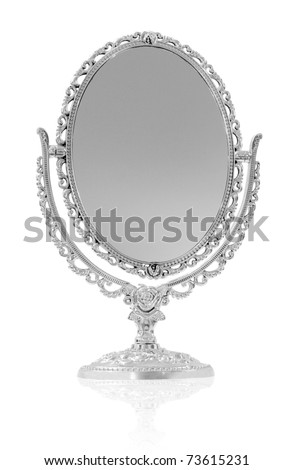 Antique mirror in front of white background - stock photo