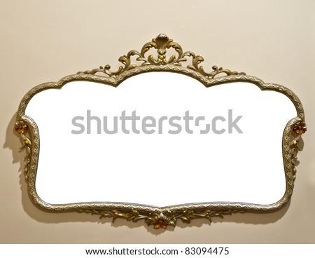 Antique mirror on grunge wall - stock photo