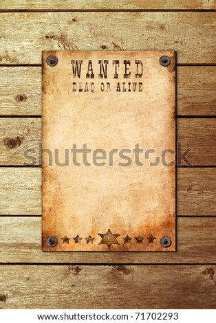 antique page - wanted dead or alive. Vintage wanted poster on a wooden wall - stock photo