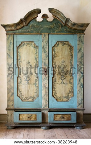 antique painted cupboard. old hand made furniture in wood with drawers and doors - stock photo