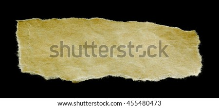 antique paper with worn edge isolated on black background. - stock photo