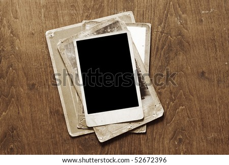Antique photos frame on wooden background - stock photo