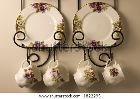 Antique plates and tea cups - stock photo