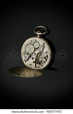 Antique pocket watches mechanic on chain with jewels inside isolated on black background. - stock photo